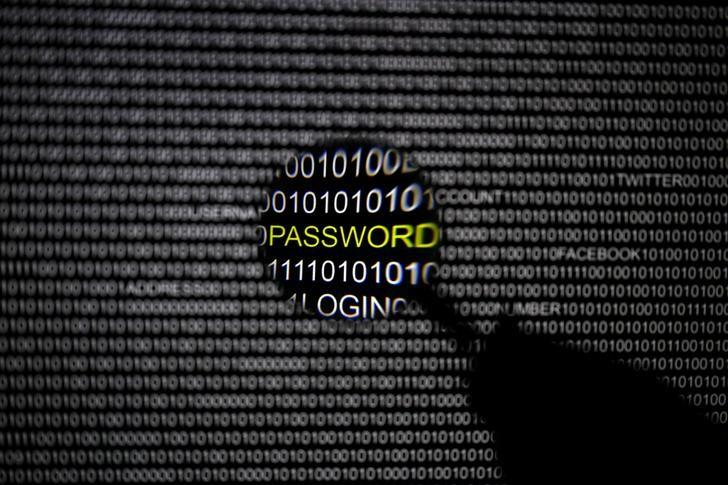 A magnifying glass is held in front of a computer screen in this picture illustration taken in Berlin May 21, 2013. The Financial Times' website and Twitter feeds were hacked May 17, 2013, renewing questions about whether the popular social media service has done enough to tighten security as cyber-attacks on the news media intensify. The attack is the latest in which hackers commandeered the Twitter account of a prominent news organization to push their agenda. Twitter's 200 million users worldwide send out more than 400 million tweets a day, making it a potent distributor of news. REUTERS/Pawel Kopczynski (GERMANY - Tags: CRIME LAW SCIENCE TECHNOLOGY)