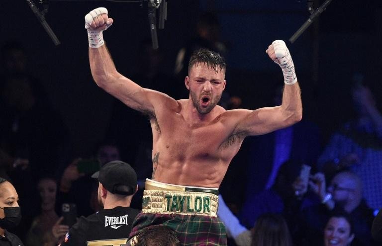 Scotland's Josh Taylor celebrates his win by unanimous decision over Jose Ramirez in their junior welterweight world unification title fight at Virgin Hotels Las Vegas