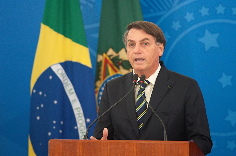 BRASILIA, BRAZIL - MARCH 27: President of Brazil Jair Bolsonaro speaks in the press conference about credit for entrepreneurs to guarantee wages during coronavirus (COVID - 19) pandemic at the Planalto Palace on March, 27, 2020 in Brasilia, Brazil. Brazil has 3,027 confirmed cases Coronavirus (COVID-19) and 77 deaths. (Photo by Andressa Anholete/Getty Images)
