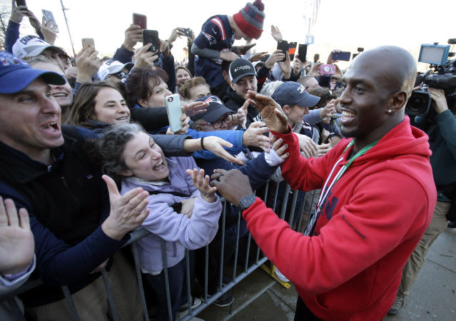 Patriots free safety Devin McCourty, right, greets fans following the football team's arrival at Gillette Stadium after Super Bowl LIII. (AP)