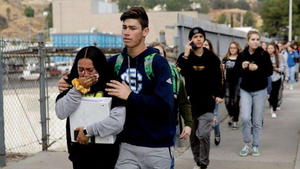 PHOTO: Students are escorted out of Saugus High School after reports of a shooting, Nov. 14, 2019, in Santa Clarita, Calif. (Marcio Jose Sanchez/AP)