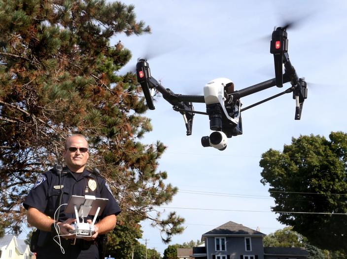 FILE - In this Sept. 16, 2015 file photo, West Salem police chief Charles Ashbeck flies his department's new drone in West Salem, Wis. More than a year after the U.S. Interior Department grounded hundreds of Chinese-made drones it was using to track wildfires and monitor dams and wildlife, the future of drone use by the federal government remains unmapped. The latest complication: Legislation moving through Congress that would block the U.S. government from using drones made in China. (Peter Thomson/La Crosse Tribune via AP)