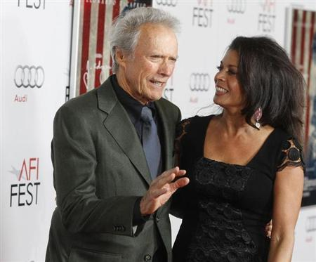 Director Clint Eastwood and his wife Dina arrive at the opening night gala for AFI Fest 2011 in Hollywood