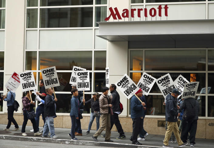Hotel workers strike in front of a Marriott hotel Thursday, Oct. 4, 2018, in San Francisco. Thousands of housekeepers, cooks and other Marriott hotel workers are on strike in San Francisco and San Jose after months of negotiating for a wage increase. (AP Photo/Ben Margot)