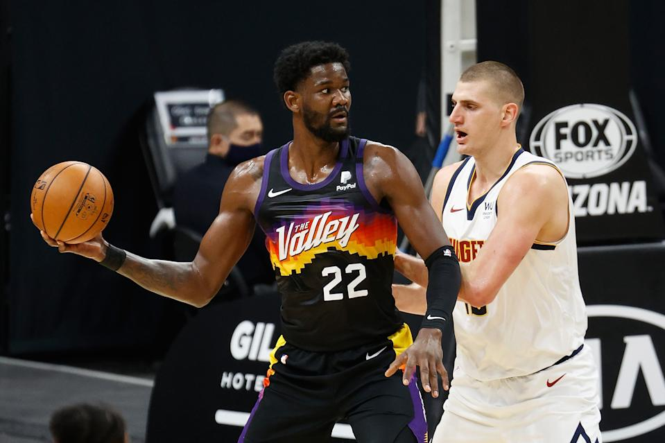 Phoenix Suns center DeAndre Ayton faces another huge playoff test against Denver Nuggets star Nikola Jokic, the NBA's likely MVP this season. (Christian Petersen/Getty Images)