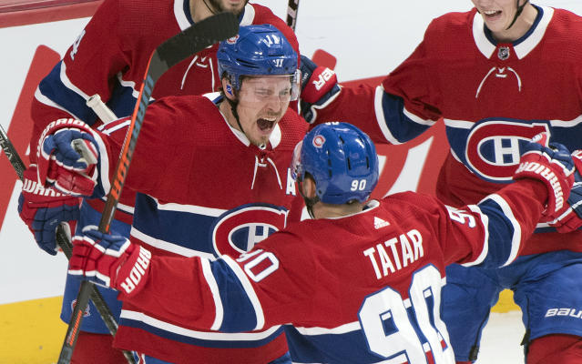 Montreal Canadiens' Brendan Gallagher (11) celebrates with teammate Tomas Tatar after scoring against the Toronto Maple Leafs during the first period of an NHL hockey game, in Montreal, Saturday, Oct. 26, 2019. (Graham Hughes/The Canadian Press via AP)