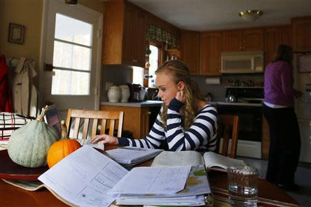 Seventeen year-old Hannah Steenhuysen works on her homework at her home in Rehobeth, Massachusetts October 25, 2013. REUTERS/Brian Snyder