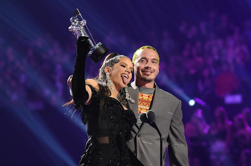 NEWARK, NEW JERSEY - AUGUST 26: ROSALÍA and J Balvin speak onstage during the 2019 MTV Video Music Awards at Prudential Center on August 26, 2019 in Newark, New Jersey. (Photo by Dimitrios Kambouris/VMN19/Getty Images for MTV)