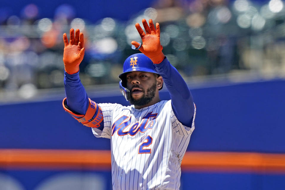 New York Mets' Dominic Smith (2) gestures to fans and teammates after hitting a RBI double during the fifth inning of a baseball game against the Baltimore Orioles, Wednesday, May 12, 2021, in New York. (AP Photo/Kathy Willens)