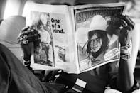<p>Percussionist Ollie Brown relaxes with a <em>Rolling Stone</em> magazine while on tour with the Rolling Stones in 1975.</p>