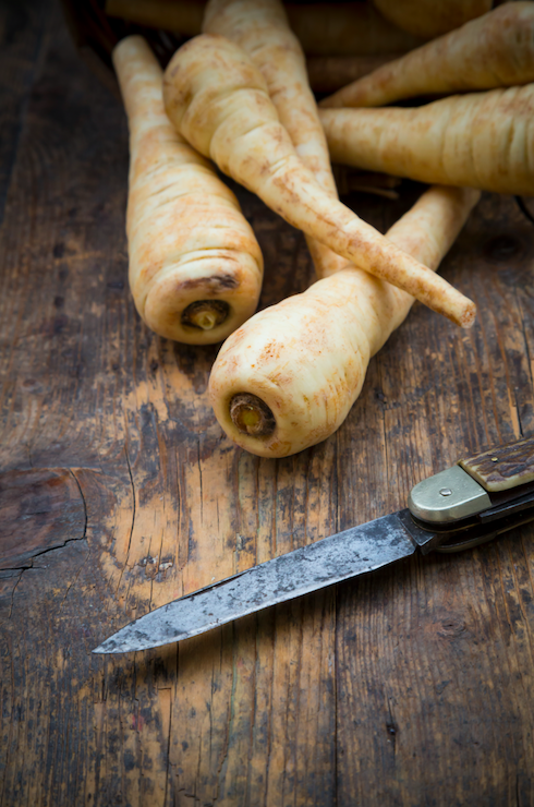 """<p>Rich in potassium and a great source of fibre, parsnips are a fantastic autumn veggie to stockpile. Almost nutty in flavour, use them to flavour rice and potatoes or puree them into soups and sauces. <a href=""""http://www.marilynglenville.com"""" rel=""""nofollow noopener"""" target=""""_blank"""" data-ylk=""""slk:Dr Marilyn Glenville"""" class=""""link rapid-noclick-resp"""">Dr Marilyn Glenville</a>, the UK's leading Nutritionist and author of <i>Natural Alternatives to Sugar</i> (Amazon.co.uk) says, """"Parsnips are a source of vitamins and minerals such as vitamin c, folate and potassium"""".</p><p><b>Ramp-up your recipe:</b></p><p>Roasted parsnips make a great side dish with your Sunday roast. Chop them into wedges and coat with olive oil or melted coconut oil, sea salt, black pepper and a few pinches of paprika. Roast the wedges on a baking tray for 45–60 minutes or until soft inside. Or make parsnip pancakes by finely grating two large or four small raw parsnips and mixing well with a beaten egg, salt and pepper, and optional chopped herbs such as chives. Cook like normal pancakes, until browned on both sides.</p><p><i>[Photo: Getty]</i></p>"""