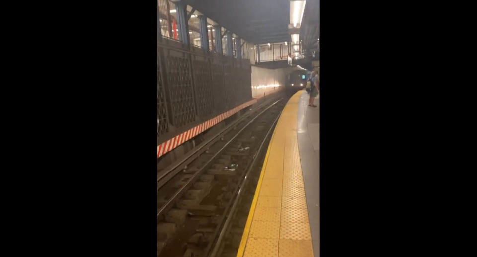 A screenshot of a video showing a train pulling into the station just seconds after the man was pulled to safety, and his rescuer also jumped back onto the platform. Source: Twitter/SubwayCreatures
