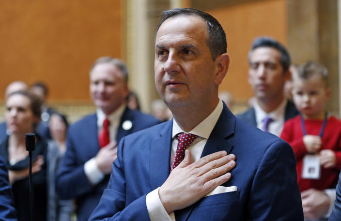 FILE - In this Jan. 22, 2018, file photo, shows Republican State Rep. Norm Thurston standing for the National Anthem during the opening of the 2018 Utah Legislature in Salt Lake City. The United States' lowest DUI threshold takes effect this weekend in Utah. Lawmakers in the state approved the 0.05 percent blood-alcohol limit in 2017, and Gov. Gary Herbert signed it into law. The change goes into effect Saturday, Dec. 29, 2018. (AP Photo/Rick Bowmer, File)