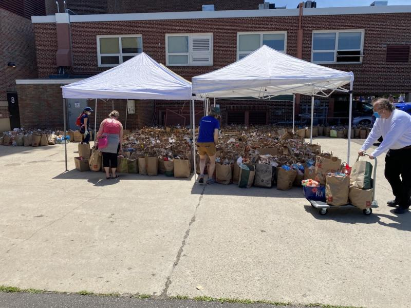 Volunteers help sort food donations outside of Sanford Middle School. (The Sheridan Story)