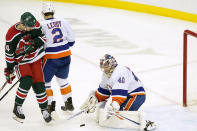 New York Islanders goaltender Semyon Varlamov (40) makes a save with Islanders defenseman Nick Leddy (2) defending New Jersey Devils right wing Nathan Bastian (14) during the second period of an NHL hockey game, Tuesday, March 2, 2021, in Newark, N.J. (AP Photo/Kathy Willens)