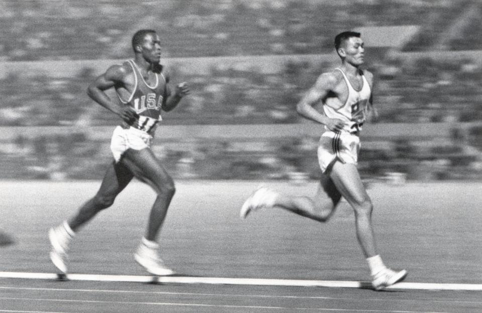ROME - 1960: Rafer Johnson of the United States competes against Yang Chuan-kwang of China in the 1500 Metres portion of the Decathlon competition during the 1960 Summer Olympics in Rome, Italy. (Photo by Robert Riger/Getty Images)
