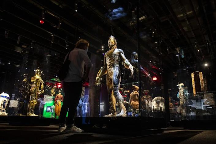 """Los Angeles, CA - September 21: The prosthetic suit worn by actor Doug Jones as the amphibian man in 2018 Oscar-winning film, """"Shape of Water,"""" by director Guillermo del Toro, center, is part of the Stories of Cinema exhibit, a multi-room experience entitled """"Inventing Worlds & Characters,"""" including, """"Encounters,"""" with some of film's most popular creations, photographed at the Academy Museum of Motion Pictures, in Los Angeles, CA, Tuesday, Sept. 21, 2021. (Jay L. Clendenin / Los Angeles Times)"""