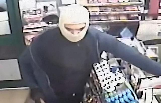 The men wore masks to carry out the robbery (Picture: SWNS)