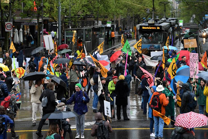 Activists from Extinction Rebellion block an intersection in Melbourne on Tuesday. Source: AAP