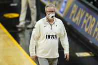 Iowa head coach Fran McCaffery walks off the court after an NCAA college basketball game against Indiana, Thursday, Jan. 21, 2021, in Iowa City, Iowa. Indiana won 81-69. (AP Photo/Charlie Neibergall)