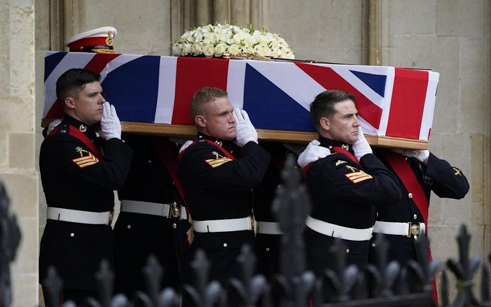 Pallbearers carry the coffin of Major General Matthew Holmes, former head of the Royal Marines, out of Winchester Cathedral following his funeral service (Andrew Matthews/PA) (PA Wire)