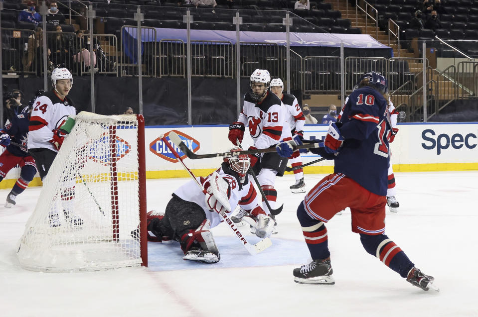 New York Rangers' Artemi Panarin (10) scores in the second period against New Jersey Devils' Mackenzie Blackwood (29) during an NHL hockey game Thursday, April 15, 2021, in New York. (Bruce Bennett/Pool Photo via AP)
