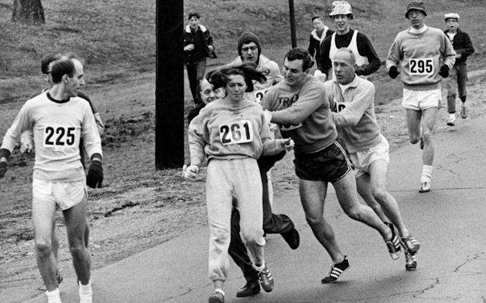 Kathrine Switzer battles through the 1967 Boston Marathon, despite others trying to stop her - GETTY IMAGES