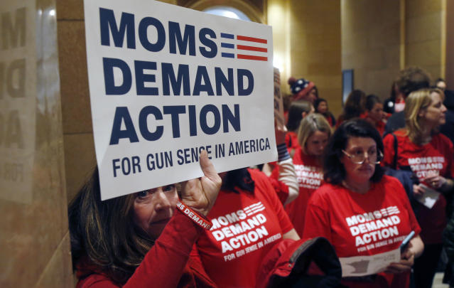 <p>Connie Ortberg, left, holds her sign as women rally at the Minnesota State Capitol Tuesday, Feb. 20, 2018, as the 2018 legislative gets underway in St. Paul, Minn., as Moms Demand Actions called on lawmakers to expand background checks and resist efforts to widen the state's gun laws after the school shooting in Florida last week. (Photo: Jim Mone/AP) </p>