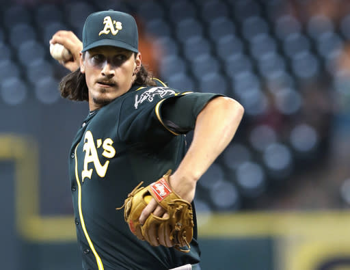 Oakland Athletics' Jeff Samardzija delivers a pitch against the Houston Astros in the first inning of a baseball game Monday, Aug. 25, 2014, in Houston. (AP Photo/Pat Sullivan)