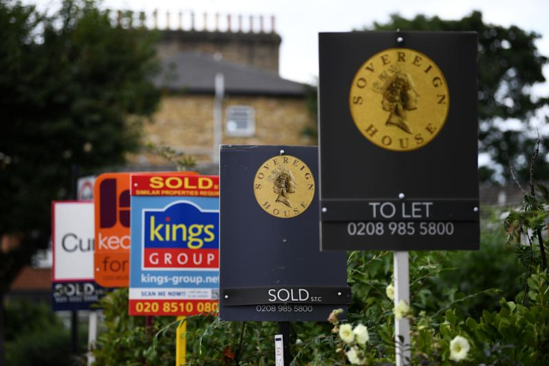 "Estate and rental agents' boards are pictured on a residential street in Hackney, east London on August 9, 2019. - House prices and sales are ""losing momentum"", surveyors say, although parts of the UK are still seeing property values rise. (Photo by Daniel LEAL-OLIVAS / AFP) (Photo credit should read DANIEL LEAL-OLIVAS/AFP/Getty Images)"