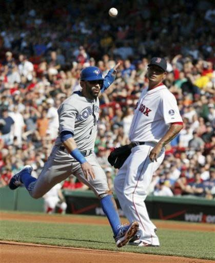 Toronto Blue Jays' Jose Bautista, left, runs past Boston Red Sox's Felix Doubront along the third base line as he is caught out between bases on a fielder's choice in the first inning of a baseball game in Boston, Saturday, June 29, 2013. (AP Photo/Michael Dwyer)