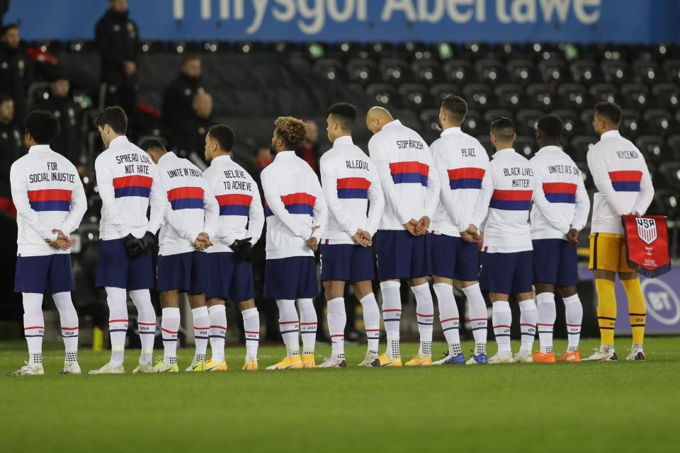 US team stand for their national anthem before the international friendly soccer match between Wales and USA at Liberty stadium in Swansea, Wales, Thursday, Nov. 12, 2020. (AP Photo/Kirsty Wigglesworth)