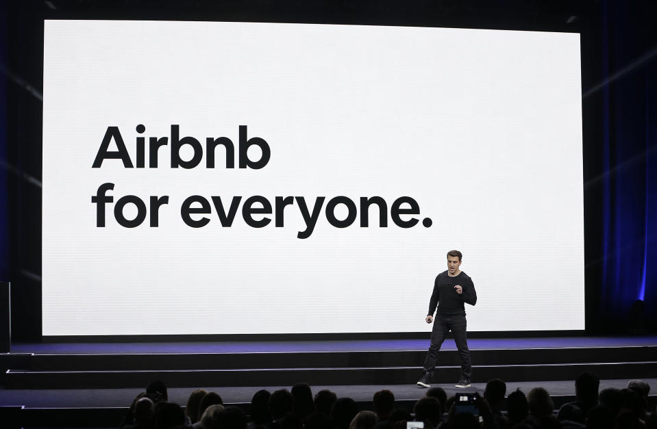 FILE - In this Feb. 22, 2018, file photo, Airbnb co-founder and CEO Brian Chesky speaks during an event in San Francisco. Activists and lawyers are targeting the IOC's most high-profile sponsors tied to next year's Beijing Winter Olympics as a way to bring light to human rights abuses in China against Muslim Uyghurs and other ethnic minorities. The top 15 IOC sponsors are household names that include Coca-Cola, Toyota, Visa, Samsung, General Electric, and Airbnb among others. (AP Photo/Eric Risberg, File)