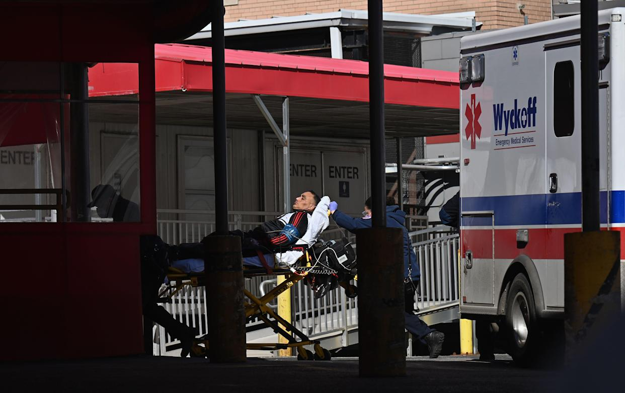 A person on a gurney is transported to Elmhurst Hospital Center on March 2, 2021 in New York City. (Angela Weiss/AFP via Getty Images)