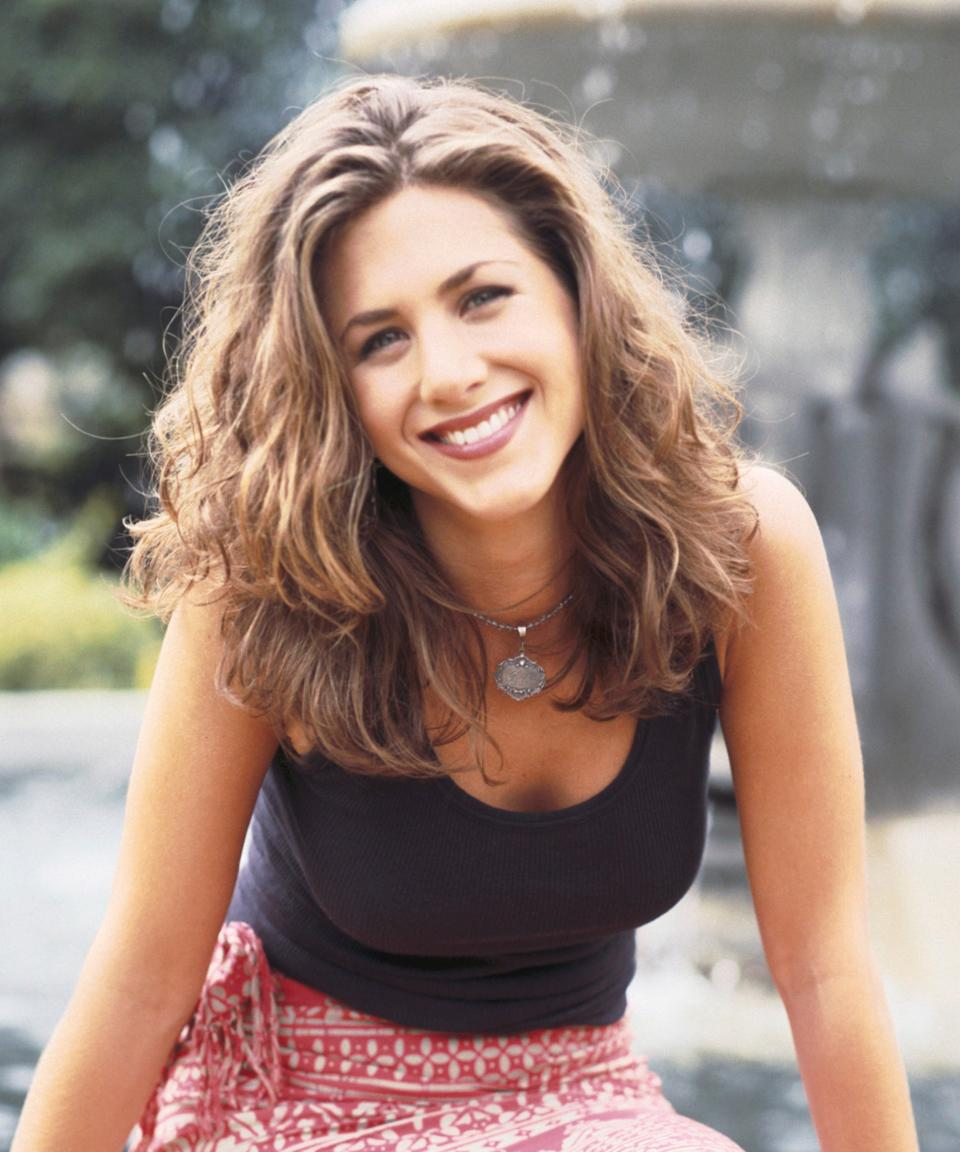"""<h3>1994: Air-Dried Tousle</h3><br>The first season of <em>Friends</em> featured a young Aniston with a shorter cut and tousled, air-dried waves (possibly from her splash in the fountain during the show's opening credits).<span class=""""copyright"""">Photo: Reisig & Taylor/NBCU Photo Bank/NBCUniversal/Getty Images.</span>"""
