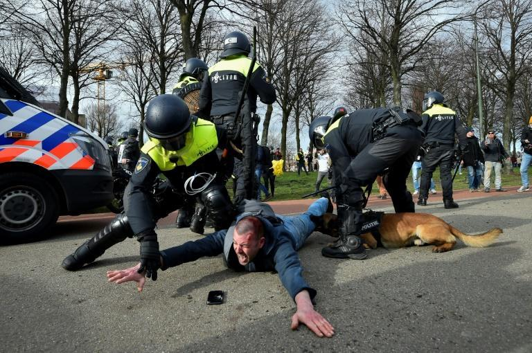 Police used water cannon and canine teams to break up anti-Rutte protests on the eve of voting