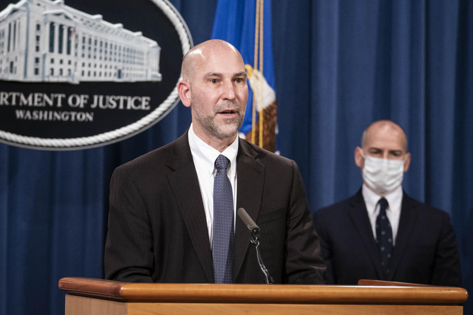 "Steven D'Antuono, head of the Federal Bureau of Investigation (FBI) Washington field office, speaks as acting U.S. Attorney Michael Sherwin, right, listens during a news conference Tuesday, Jan. 12, 2021, in Washington. Federal prosecutors are looking at bringing ""significant"" cases involving possible sedition and conspiracy charges in last week's riot at the U.S. Capitol. (Sarah Silbiger/Pool via AP)"