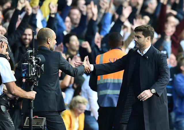 Tottenham Hotspur's Argentinian head coach Mauricio Pochettino (R) shakes hands with Manchester City's Spanish manager Pep Guardiola after the English Premier League football match between Tottenham Hotspur and Manchester City on October 2, 2016 (AFP Photo/Glyn Kirk)