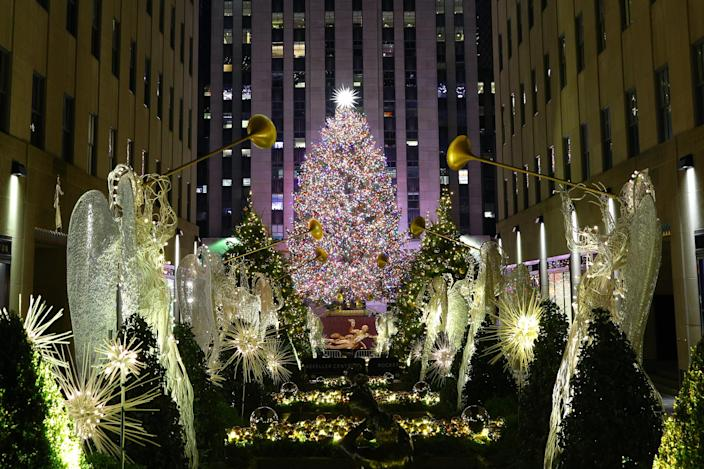 Angels with trumpets line the garden leading to the Christmas tree in Rockefeller Center. (Photo: Gordon Donovan/Yahoo News)