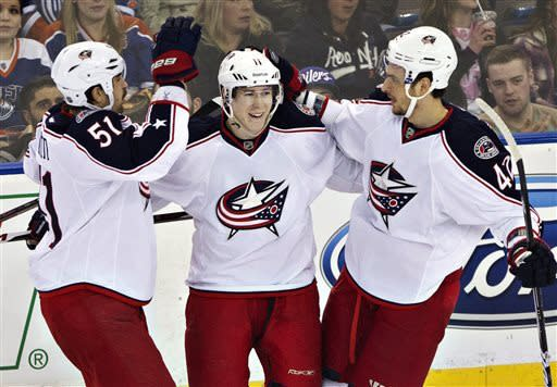 Columbus Blue Jackets' Fedor Tyutin (51), Matt Calvert (11) and Artem Anisimov celebrate Calvert's goal against the Edmonton Oilers during the first period of their NHL hockey game, Thursday, March 28, 2013, in Edmonton, Alberta. (AP Photo/The Canadian Press, Jason Franson)