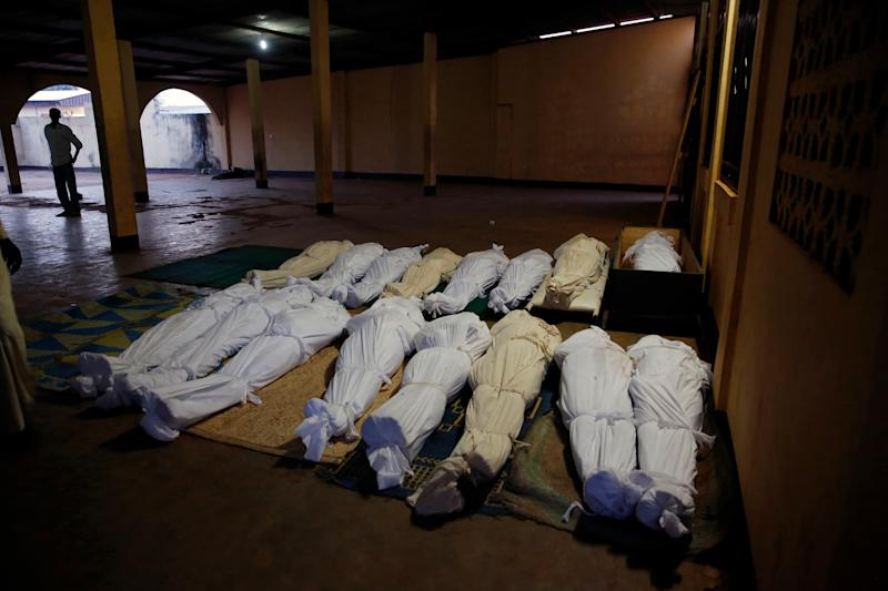 Shrouded bodies lay in a mosque in Bangui, Central African Republic, Thursday Dec. 5 2013 following a day-long gun battle between Seleka soldiers and Christian militias. Over 40 bodies, civilian and some military, have been brought for funeral preparations. Gunfire and mortar rounds erupted in the town, leaving scores dead and wounded. To try to put an end to sectarian violence, the UN security council passed a motion allowing French troops to deploy in the country in order to protect civilians and insure security by all necessary means. (AP Photo/Jerome Delay)