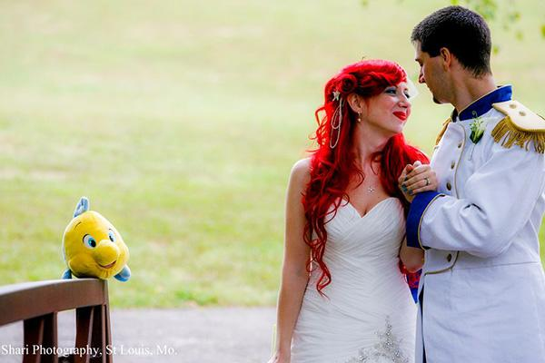 """photo by:Shari Photography<br> Jamie hatched the idea for a Disney-themed wedding after a childhood spent watching Disney movies and visiting Disney World on yearly family vacations. """"There's something about Disney that makes me feel happy and safe,"""" she says. Christopher even proposed at Disney World against the backdrop of fireworks."""