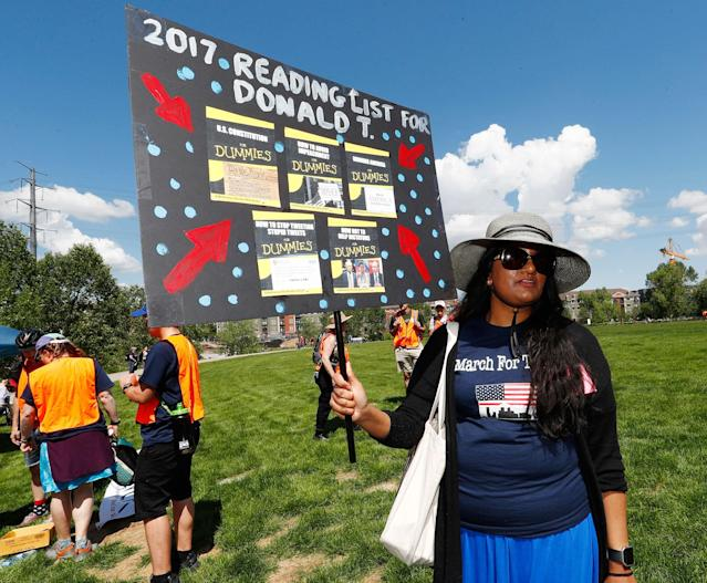 <p>Rissa Khan of Denver holds up a sign during a protest against the polices of President Donald Trump on Saturday, June 3, 2017, in downtown Denver. (Photo: David Zalubowski/AP) </p>