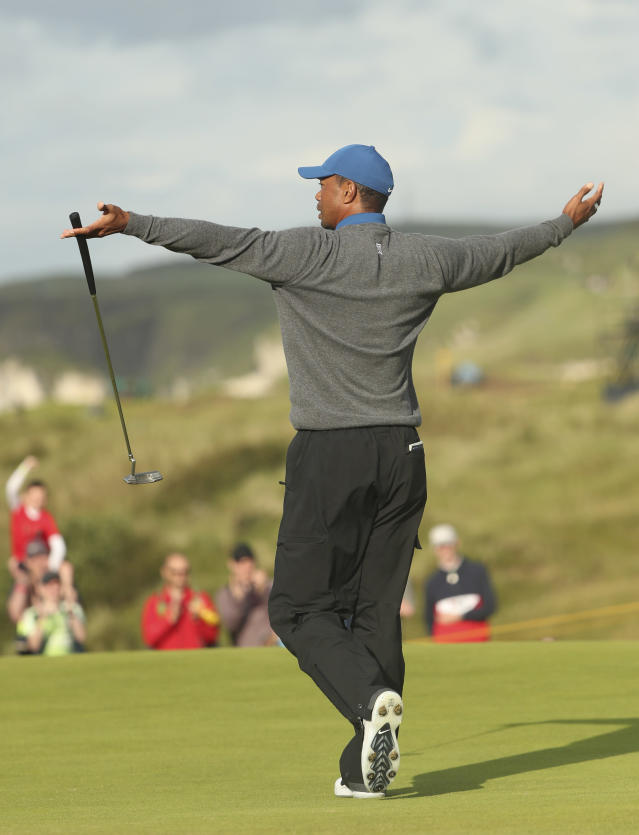 Tiger Woods of the United States celebrates after getting a birdie on the 16th green during the first round of the British Open Golf Championships at Royal Portrush in Northern Ireland, Thursday, July 18, 2019.(AP Photo/Jon Super)