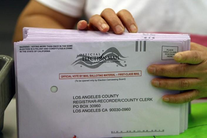 """President Trump's full-out assault on voting by mail suggests a strategy he could use for refusing to accept election results. <span class=""""copyright"""">(Allen J. Schaben / Los Angeles Times)</span>"""