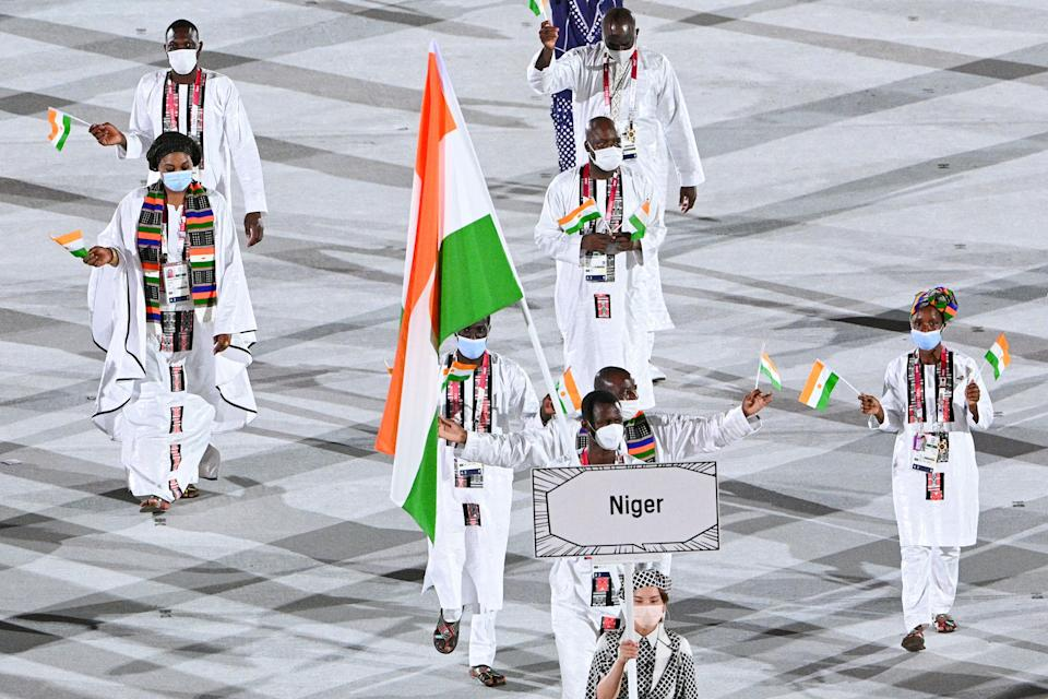 <p>Niger's delegation parade during the opening ceremony of the Tokyo 2020 Olympic Games, at the Olympic Stadium, in Tokyo, on July 23, 2021. (Photo by Martin BUREAU / AFP) (Photo by MARTIN BUREAU/AFP via Getty Images)</p>