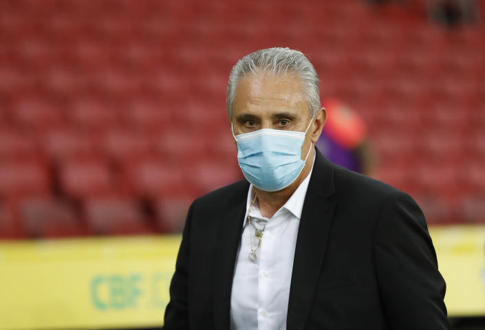 Brazil's coach Tite looks on prior a qualifying soccer match against Ecuador for the FIFA World Cup Qatar 2022 at Beira-Rio stadium in Porto Alegre, Brazil, Friday, June 4, 2021. (AP Photo/Andre Penner)