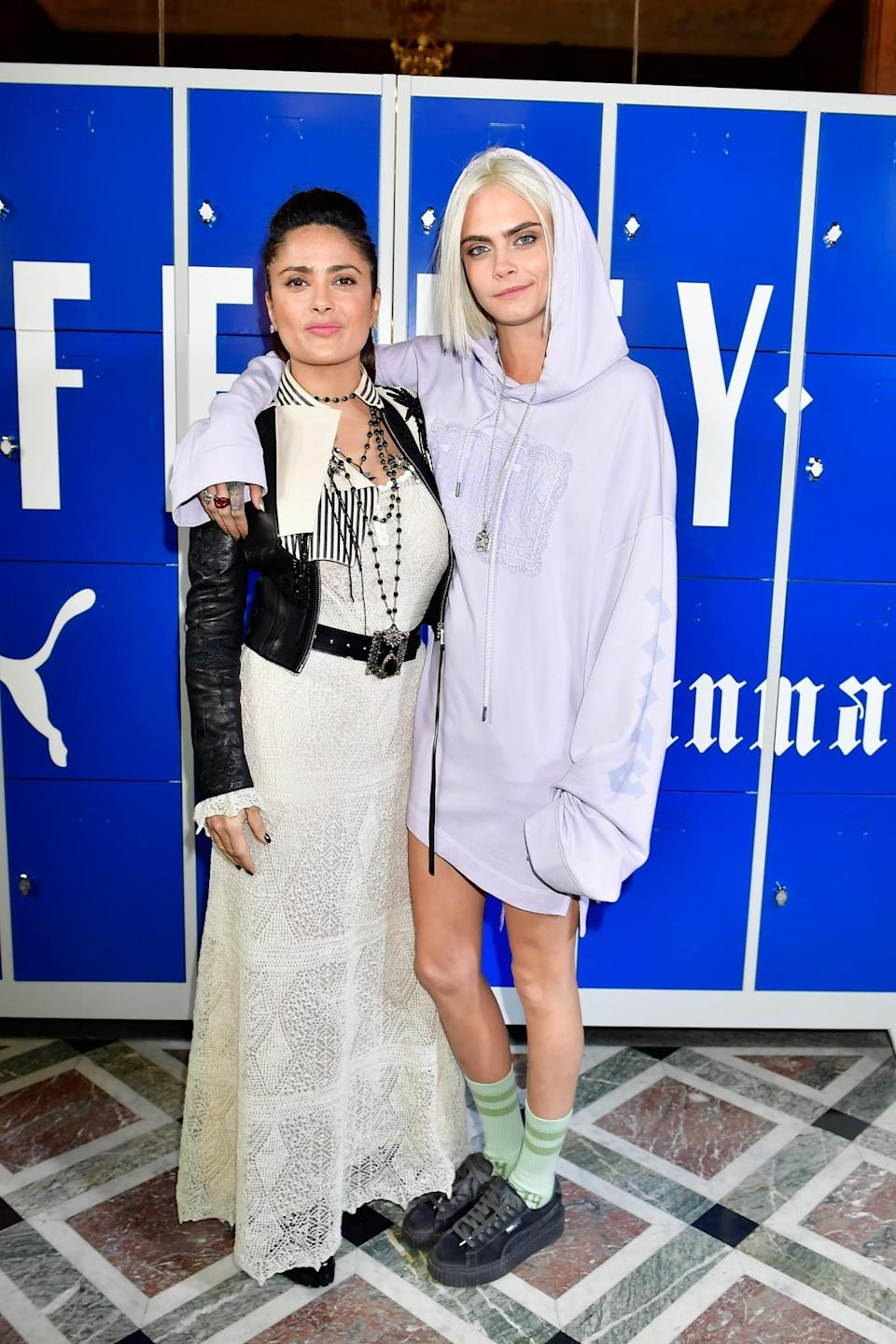 <p>Salma Hayek and Cara Delevingne posed in contrasting looks. <i>[Photo: Getty]</i> </p>