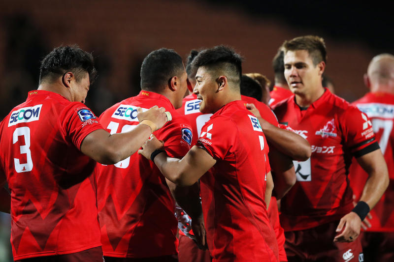 Sunwolves prop Hiroshi Yamashita and Sunwolves flanker Shuhei Matsuhashi, center right, celebrate their victory in the Super Rugby match between the Sunwolves and the Chiefs in Hamilton, New Zealand, Saturday, March 2, 2019. (AP Photo/Bruce Lim)