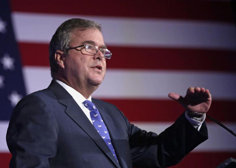 FILE - In this Aug. 9, 2013 file photo, former Florida Gov. Jeb Bush speaks in Chicago. To say that new academic standards have yielded strange bedfellows would be an understatement. Republican-on-Republican infighting? Teacher unions linking arms with tea partyers? President Barack Obama working in tandem with the U.S. Chamber of Commerce and energy giant Exxon? When it comes to Common Core, forget the old allegiances. Traditionally Democratic-leaning groups don't like the standardized tests and are finding allies among small-government conservatives. The Obama administration wants more students leaving high school ready for college courses or their first jobs, a goal shared by big corporations. (AP Photo/M. Spencer Green, File)